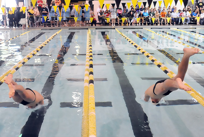 Thompson Valley High School's Adonis Reiler, left, and Jack Brubacher dive in at the start of the 50-yard freestyle finals during the Northern Conference Championships on Saturday, May 15, 2010 at the Dick Hewson Aquatic Center.