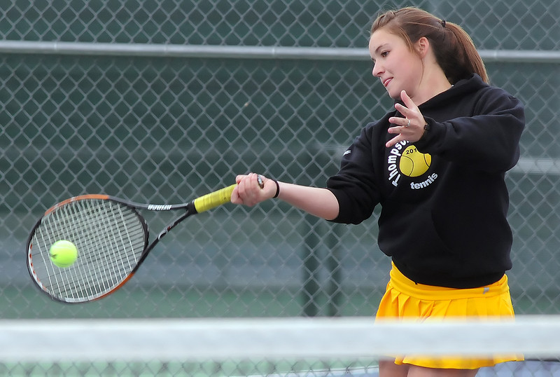 Thompson Valley High School's Lil Broussalian returns a shot during her No. 1 singles match against Mountain View's Jordan Holland on Monday at the MVHS tennis courts.