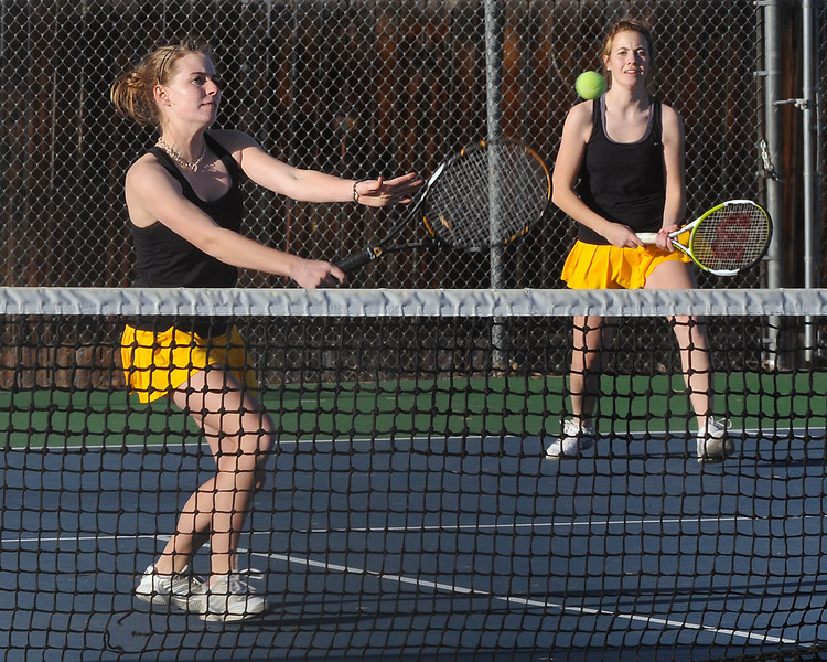 Thompson Valley High School's Allison Donelan, left, returns a shot at the net while No. 1 singles teammate Lexi Newgord looks on during their match against Greeley West on Thursday, March 11, 2010 at TVHS.