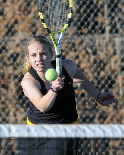 Thompson Valley High School sophomore Andrea Brush hits a shot at the net during a match against Greeley West's Candice Krammer on Thursday, March 11, 2010 at TVHS.