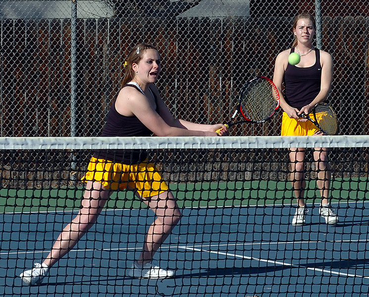 Thompson Valley #1 Doubles players Shannon Galligan, left, and Alison Donehan play during a match against Loveland Monday.