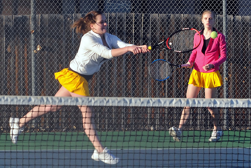 Thompson Valley High School's Shannon Galligan, left, returns a shot while teammate Kenzie Phillips looks on during their No. 3 doubles match against Rachel Marion and Shelby Thompson of Greeley West on Thursday, March 11, 2010 at TVHS.