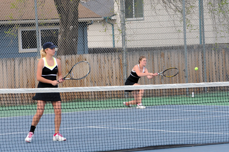 Thompson Valley High School's Samantha Sheets, right, returns a shot while her No. 2 doubles partner Emily Erickson plays at the net during their match on Friday, March 30, 2012 at TVHS.