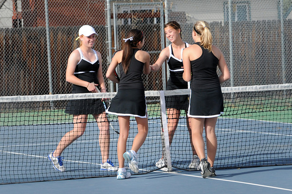 Thompson Valley High School's Kaley Hernblom, back left, and Kaitlyn Hill, back right, shake hands at the end of their No. 2 doubles match against Loveland's Ashlyn Wong, front left, and Katie Nottberg on Friday, March 30, 2012 at TVHS.