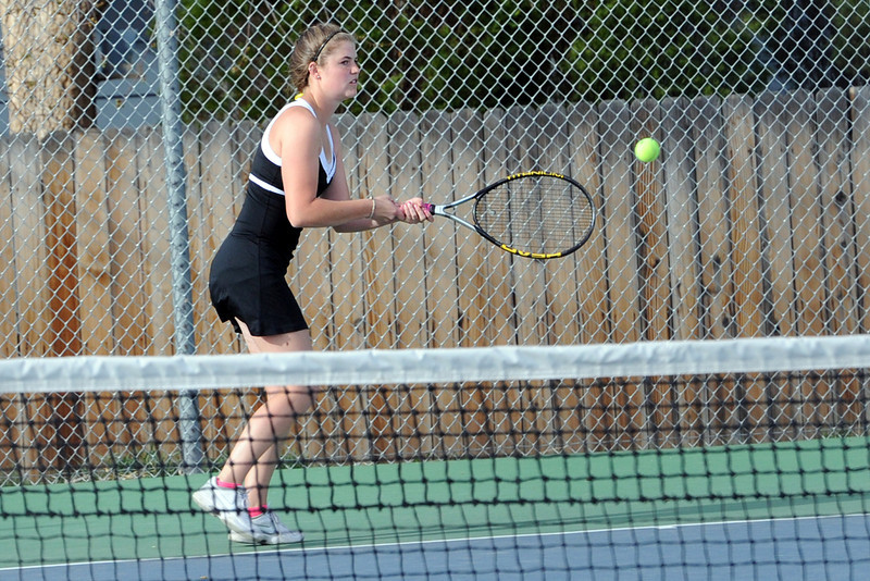 Thompson Valley High School's Samantha Sheets returns a shot during her No. 2 doubles match Friday, March 30, 2012 at TVHS.