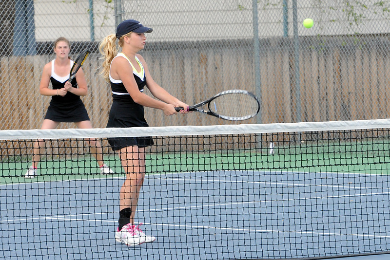 Thompson Valley High School's Emily Erickson, front, returns a shot while her No. 2 doubles partner Samantha Sheets looks on during their match on Friday, March 30, 2012 at TVHS.