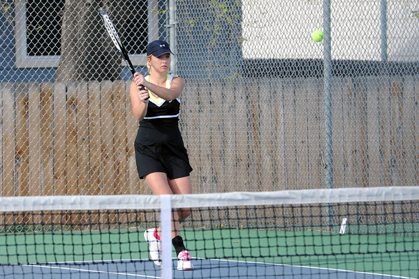 Thompson Valley High School's Emily Erickson returns a shot during her No. 2 doubles match on Friday, March 30, 2012 at TVHS.