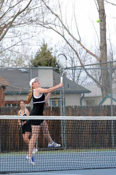Thompson Valley High School's Kaitlyn Hill, front, returns a shot while her No. 2 doubles partner Kaley Hernblom looks on during their match against Loveland's Ashlyn Wong and Katie Nottberg on Friday, March 30, 2012 at TVHS.