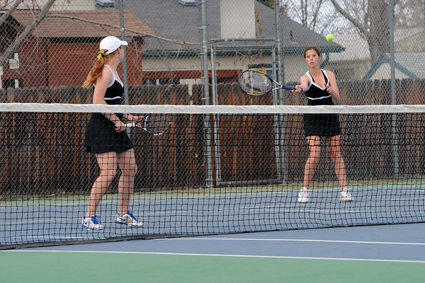 Thompson Valley High School's Kaley Hernblom, right, returns a shot while her No. 2 doubles partner Kaitlyn Hill looks on during their match against Loveland's Ashlyn Wong and Katie Nottberg on Friday, March 30, 2012 at TVHS.