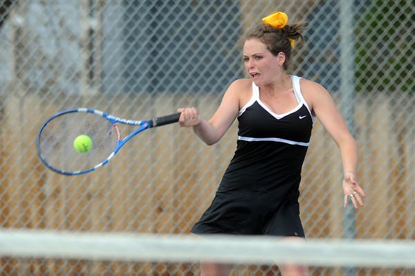 Thompson Valley High School's Shannon Galligan returns a shot during her No. 3 singles match against Loveland's Joelle Foster on Friday, March 30, 2012 at TVHS. Galligan won 6-2, 6-2.