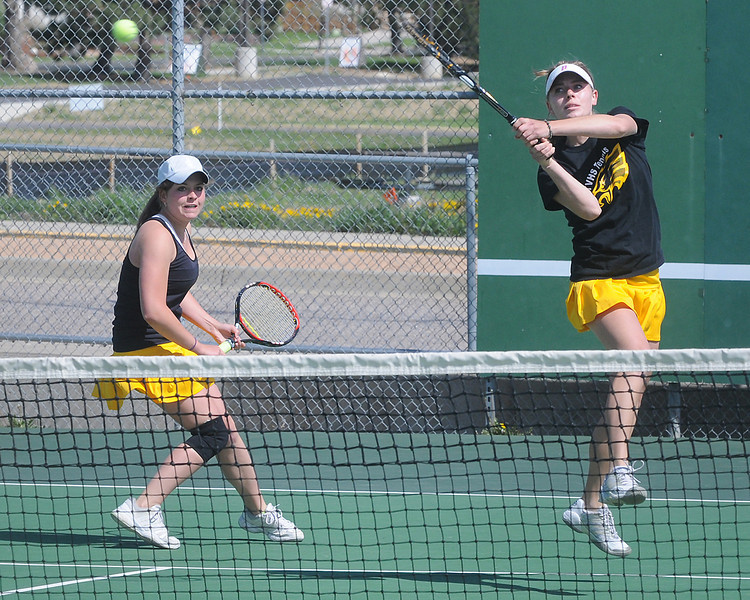 Thompson Valley High School's Allison Donelan, right, returns a shot while her No. 1 doubles teammate Shannon Galligan looks on during their match against Centaurus' Becca Bird and Milena Van der Veen on Wednesday at the Broomfield Swim and Tennis Club.
