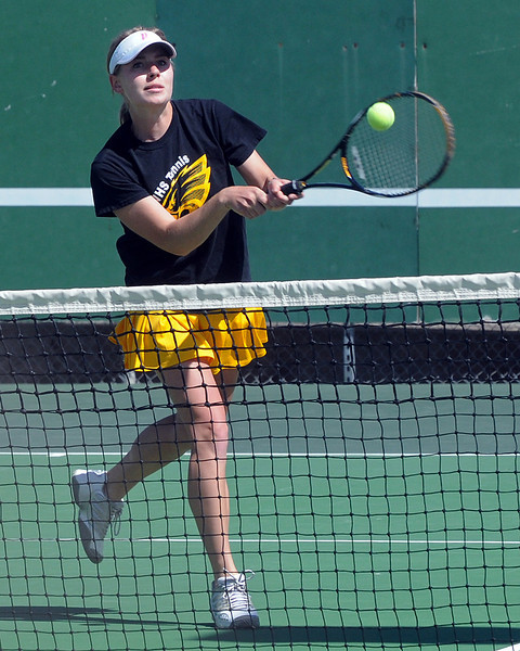 Thompson Valley High School's Allison Donelan returns a shot during her No. 1 doubles match with teammate Shannon Galligan, not pictured, Wednesday at the Broomfield Swim and Tennis Club.