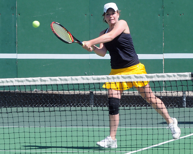 Thompson Valley High School's Shannon Galligan returns a shot during her No. 1 doubles match with teammate Allison Donelan, not pictured, Wednesday at the Broomfield Swim and Tennis Club.