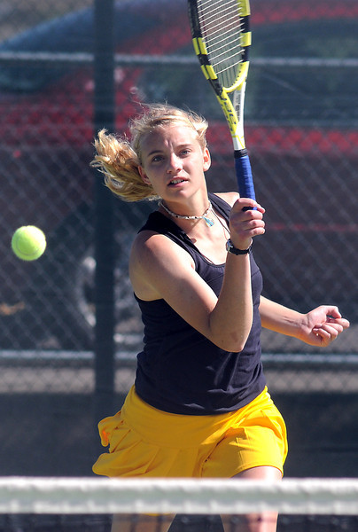 Thompson Valley High School's Andrea Brush hits a shot at the net during her match against Niwot's Morgan Mulshine on Wednesday at the Broomfield Swim and Tennis Club.