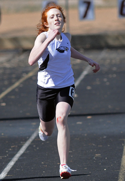 Thompson Valley High School freshman Hannah Carlson sprints toward the finish during the 200-meter dash Saturday at the Windsor Invitational. Carlson finished in second place with a time of 29.20 seconds.