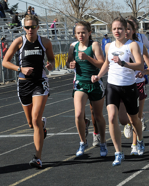 Thompson Valley High School senior Becky Schmidt, right, and Roosevelt senior Brooke wells lead the pack around the track early on during the 3200-meter run Saturday at the Windsor Invitational. Schmidt finished in first place with a time of 11 minutes, 34.43 seconds and Wells came in second at 12:17.24.