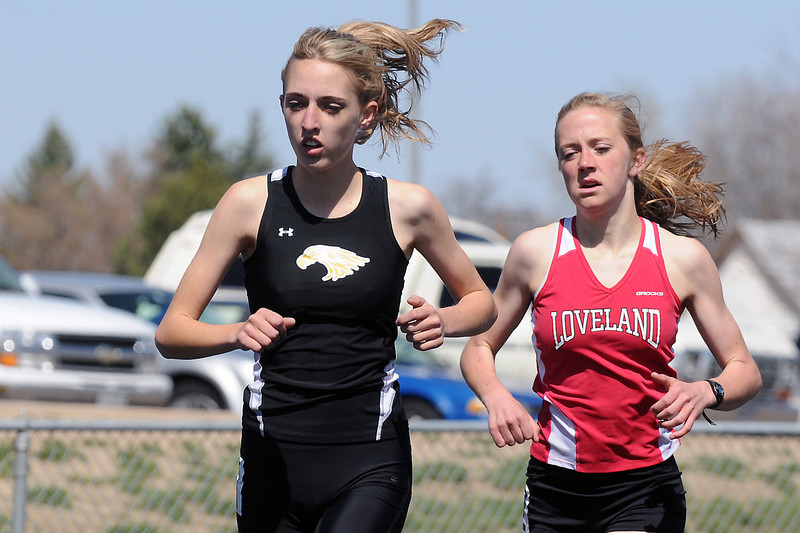 Thompson Valley High School junior Karina Ernst, left, and Loveland's Kailie Hartman compete in the 1600-meter run Friday during the R2-J Invitational at the LHS track.