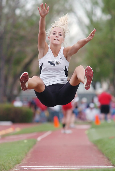 Thompson Valley High School's Katie Lindenmuth flies through the air while competing in the long jump during the Class 4A State Track and Field Championships on Friday, May 21, 2010 at Jeffco Stadium in Lakewood. Lindenmuth won the event with a jump of 17 feet, 3 inches.