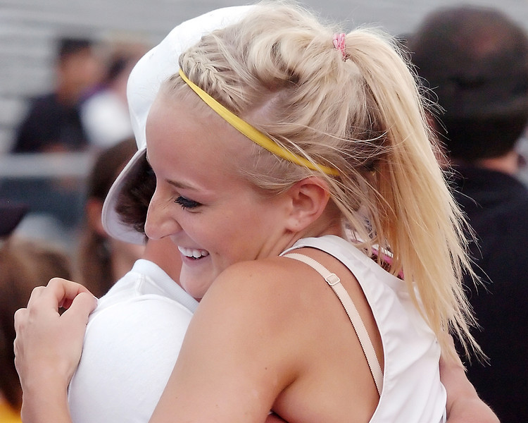 Thompson Valley High School junior Katie Lindenmuth gets a congratulatory hug from Max Schoen after she won the long jump during the Class 4A State Track and Field Championships on Friday, May 21, 2010 at Jeffco Stadium in Lakewood.