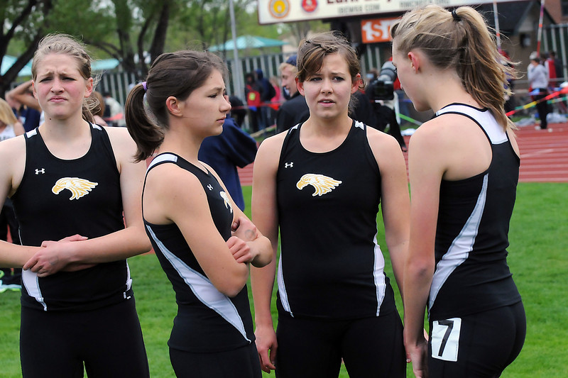 Thompson Valley High School teammates, from left to right, Gina Schmitt, Natalie Howard, Hayley Berg and Karina Ernst discuss their race after competing in the 3200-meter relay during the Class 4A State Track and Field Championships on Thursday, May 19, 2011 at Jeffco Stadium in Lakewood, Colo.