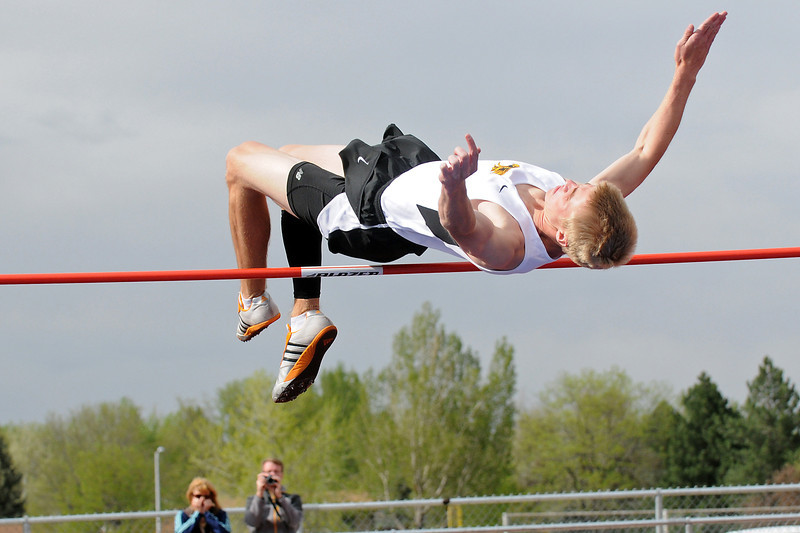 Thompson Valley High School senior Jay Cooper clears the bar while competing in the high jump during the Northern Conference Track and Field Championships Tuesday at Broomfield High School.