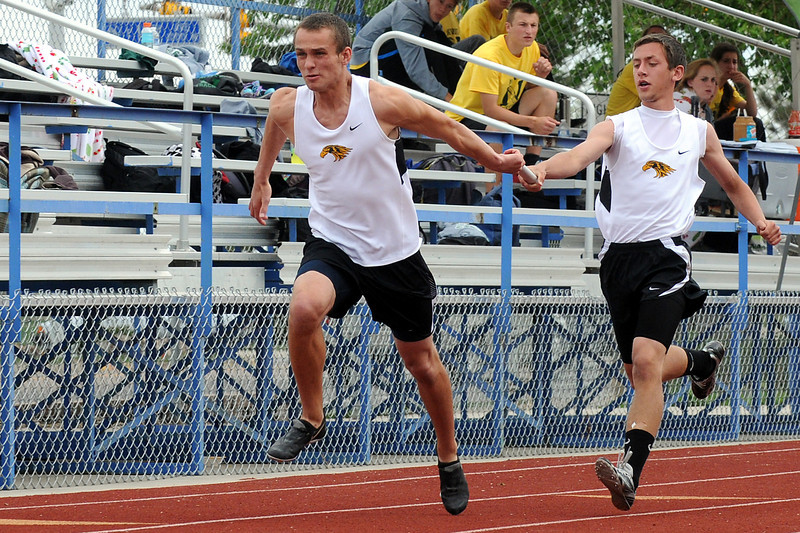 Thompson Valley High School's Kraig Burleson, right, hands the baton to teammate Josh Mielke while competing in the 400-meter relay during the Northern Conference Track and Field Championships on Tuesday, May 10, 2011 at Broomfield High School.