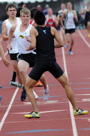 Thompson Valley High School's Ben Williamson, middle, negotiates his way through the exchange area after receiving the baton from teammate Roe Kuykendall while competing in the 3200-meter relay for the Class 4A State Track and Field Championships on Thursday, May 19, 2011 at Jeffco Stadium in Lakewood. The Eagles squad finished in third place.