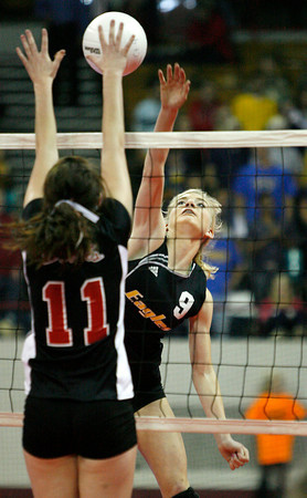 Thompson Valley's Katie Ayres spikes the ball on Eagle Valley's Shelley Wright on Friday at The Denver Coliseum. (Photo by Gabriel Christus)