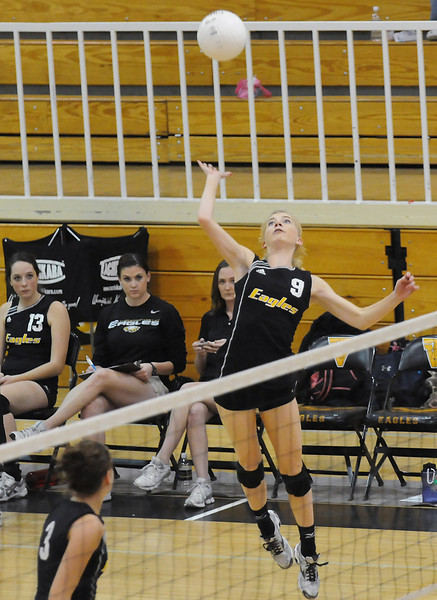 Thompson Valley High School junior Katie Ayres rises up to spike the ball during game two of a match against Silver Creek on Saturday at TVHS during the Class 4A Region B Volleyball Tournament.