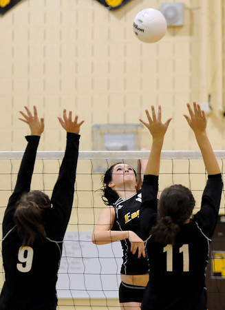 Thompson Valley High School junior Meghan Miller, back, goes up for a spike during game two of a match against Silver Creek during the Class 4A Region B Volleyball Tournament on Saturday at TVHS.