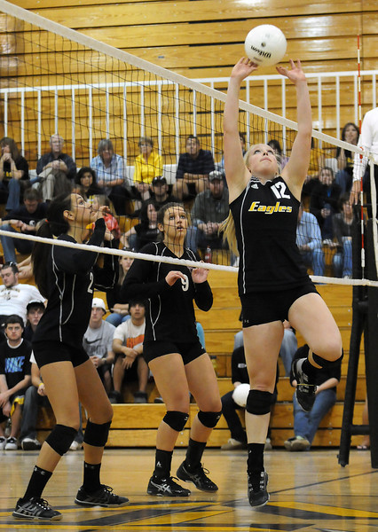 Thompson Valley High School senior Ciara Krenning sets the ball in game three of a match against Silver Creek during the Class 4A Region B Volleyball Tournament on Saturday at TVHS.