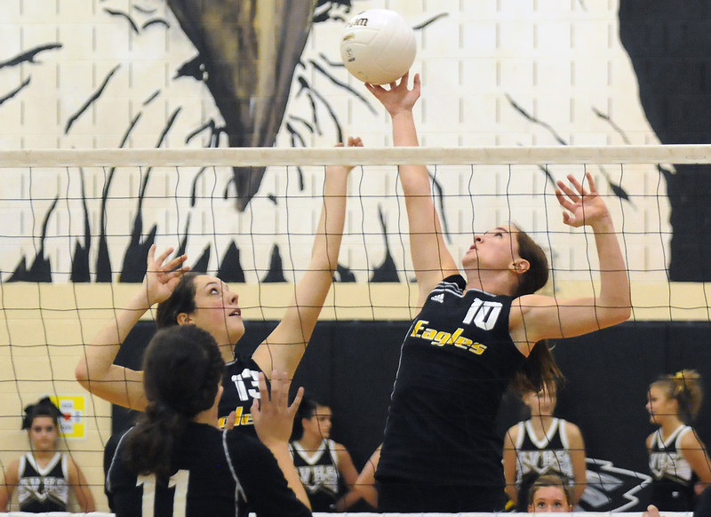 Thompson Valley High School teammates Emily Newton (13) and Hannah Creed (10) play at the net together during game two of a match against Silver Creek during the Class 4A Region B Volleyball Tournament on Saturday at TVHS.