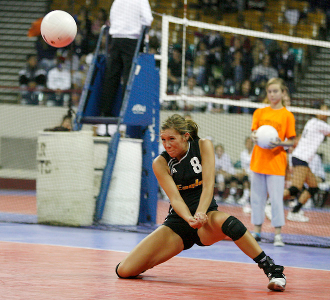 Thompson Valley's Sara Hewson digs the ball during the game against Eagle Valley on Friday at The Denver Coliseum. (Photo by Gabriel Christus)