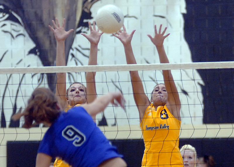 Thompson Valley's #3 Lindsey Laws, left, and #8 Sars Hewson block Mountain Views #9 Devyn Mueller during their match Monday at Thompson Valley.