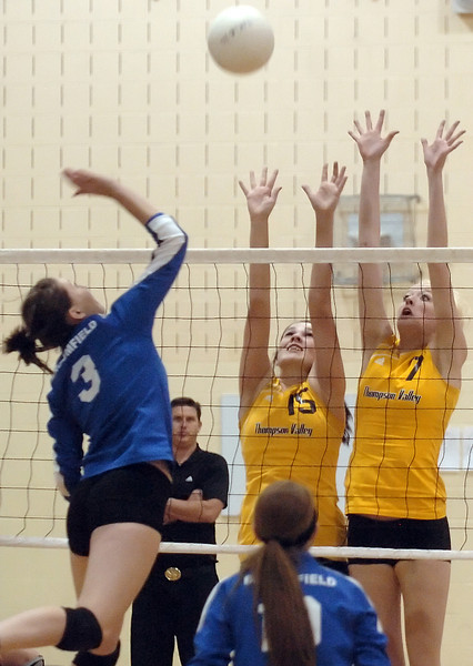 Thompson Valley High School's Erin Marolf, right, and Meghan Miller go up to block a spike by Broomfield's Lauren Knox during game one of the finals match for the Class 4A District 1 Volleyball Tournament on Saturday at TVHS. Thompson Valley won, 3-0.