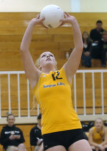 Thompson Valley High School senior Ciara Krenning sets the ball during game one of the finals match against Broomfield for the Class 4A District 1 Volleyball Tournament on Saturday at TVHS. Thompson Valley won, 3-0.
