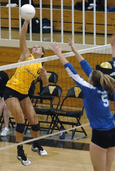 Thompson Valley High School senior Sara Hewson goes up to spike the ball over Broomfield's Kristen Leenerman during game two of the finals match for the Class 4A District 1 Volleyball Tournament on Saturday at TVHS. Thompso Valley won, 3-0.