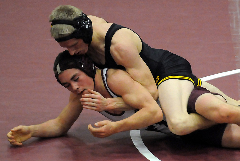 Thompson Valley High School's Kyle McNally, top, and Berthoud's Nick Fleegal compete in the 145-pound match Friday night at BHS during their dual meet. McNally won by pin in the second period.