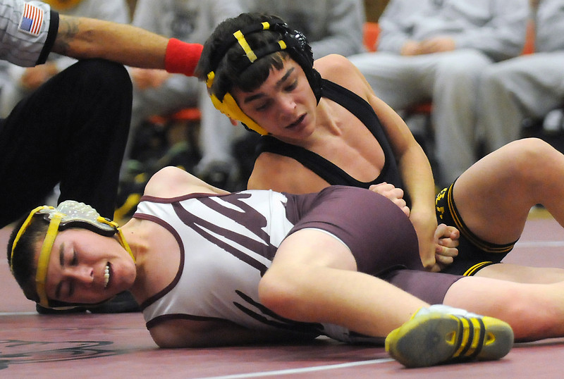Thompson Valley High School's Travis Felker, top, competes against Berthoud's Austin Bending in the first period of their 119-pound match Friday at BHS. Felker won by pin in the third period.
