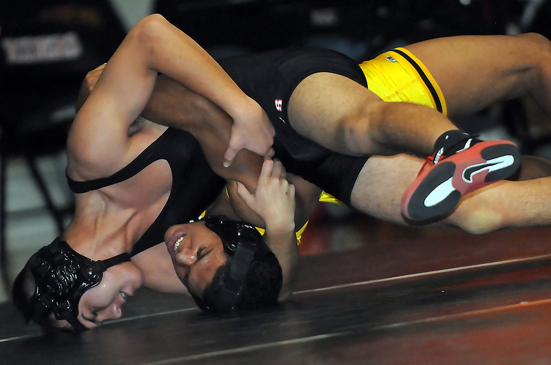Roosevelt High School's Raul Maldonado, left, battles against Thompson Valley's Joe Chavez in the 152-pound final Saturday night during the Roosevelt Invitational in Johnstown. Maldonado won, 12-0.