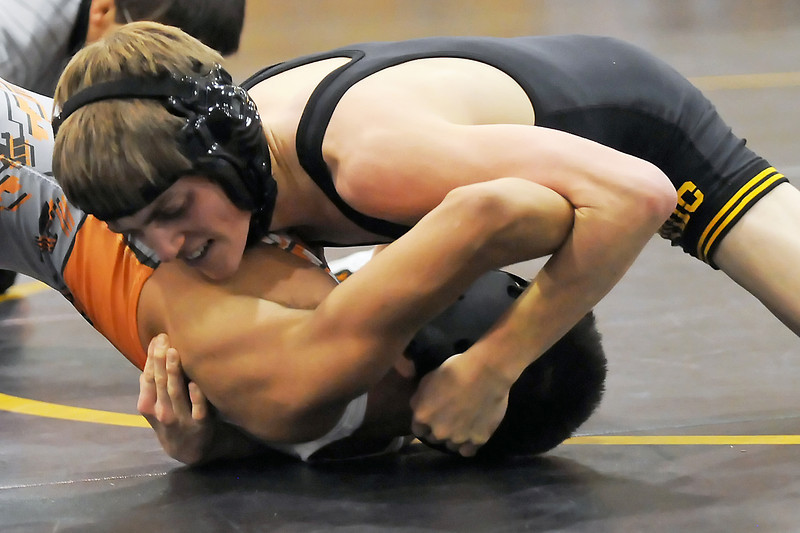 Thompson Valley High School senior, top, wrestles against Sterling's Bryan Martinez during the Class 4A Region 3 Wrestling Tournament on Friday, Feb. 11, 2011 at TVHS. Taylor won by pin in the first period.