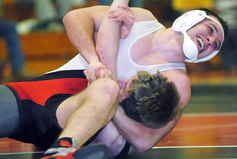 Loveland High School's Caleb Tebbe, top, wrestles Cody Anderson of Thompson Valley during the 171-pound match Friday at LHS. Tebbe, won, 11-6.