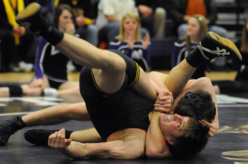 Mountain View High School wrestler wraps up Thompson Valley opponent on his way to a pin in the 160-pound bout during a meet Thursday night at Mountain View High School.