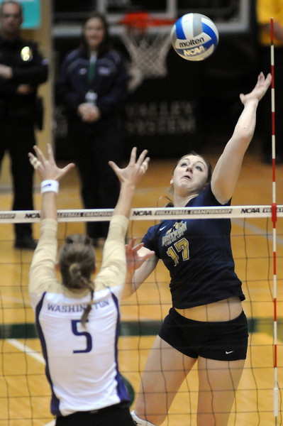 Former Berthoud High School standout Kelley Arnold powers the ball past Kindra Carlson on Thursday night during the first game of a first-round playoff match against the Washington Huskies.