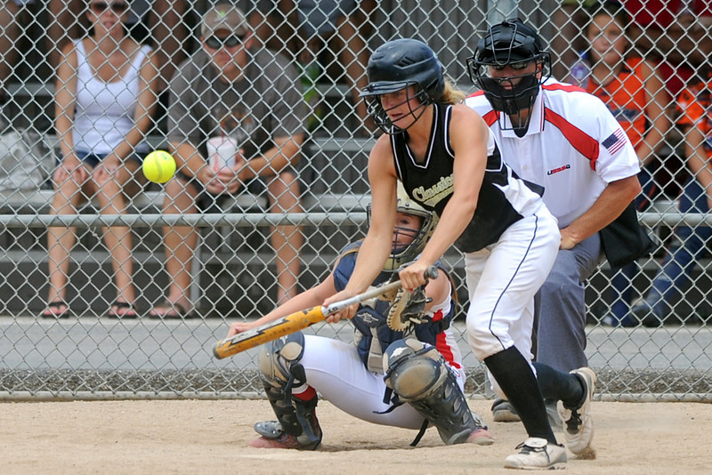 Colorado Classics player Addie Coldiron hits a sacrifice bunt in the bottom of the third inning of the USSSA championship game against the Warriors at the Barnes Softball Complex on Sunday, July 15, 2012.