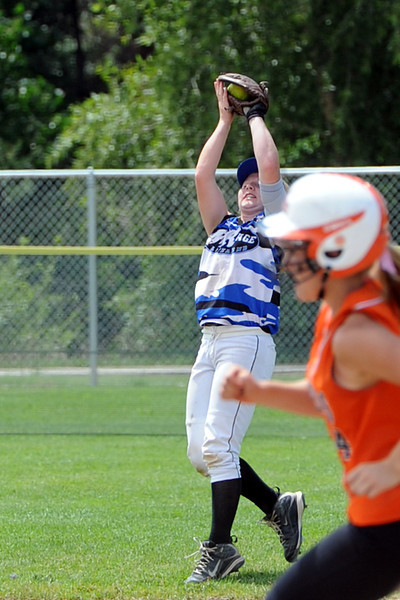 Loveland Rage left fielder Lauren Bending catches a pop fly during a game against the Lakewood Tigers at the Barnes Softball Complex on Saturday, July 14, 2012.
