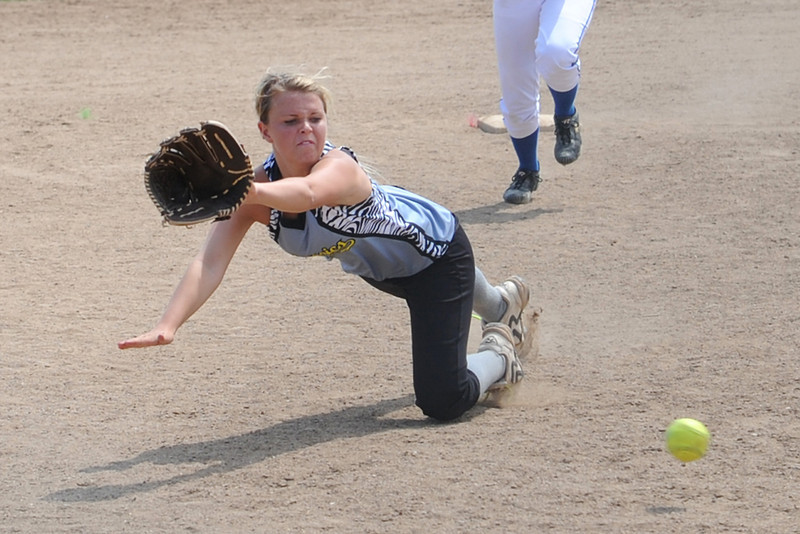 Loveland Classics shortstop Bradey King stretches out to try and stop a ground ball that just got past her glove during a game against the Lady Larks at the Barnes Softball Complex on Saturday, July 14, 2012.