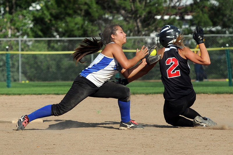 Loveland Rage shortstop Maria Preciado tags out Hitstreak baserunner Lyndsey Knabenshar at second base on a steal attempt during their game at the Barnes Softball Complex on Friday, July 13, 2012.