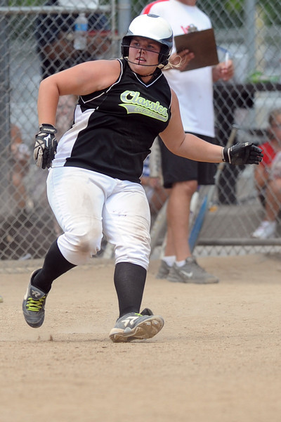 Colorado Classics player Anna Gerhard checks up at first base after hitting a single in the bottom of the first inning of the USSSA championship game against the Warriors at the Barnes Softball Complex on Sunday, July 15, 2012.