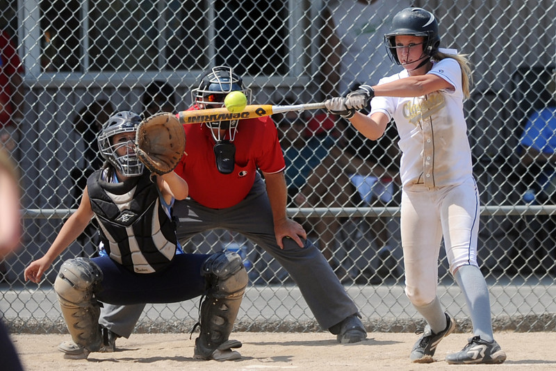Colorado Classics batter Annika Anderson hits a triple during a game against the Majestix at the Barnes Softball Complex on Friday, July 13, 2012. The Classics won, 9-4.